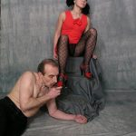 Dominatrix in stocking and fishnets